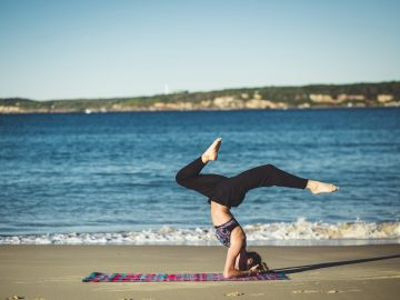Photo of a woman doing yoga on the beach